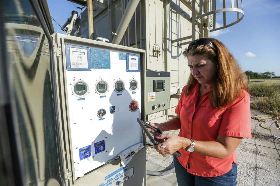 Gaye Hester of Welder Exploration & Production uses an app created by WellAware to review oil well data in Beeville. Since the slowdown in the oil patch, energy companies are more interested in tech tools that help them produce more for less. Photo: Michael Ciaglo, Staff / © 2015  Houston Chronicle