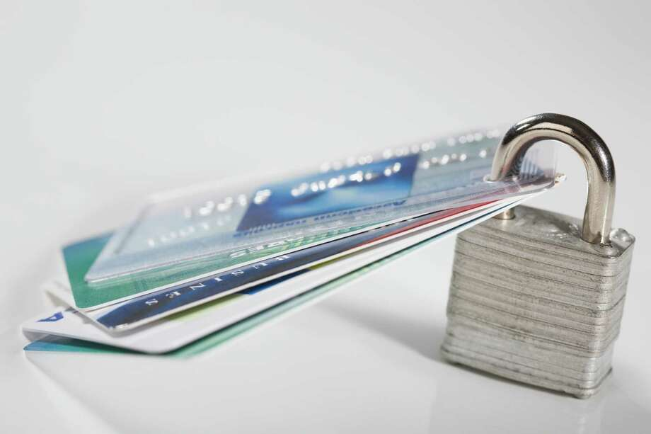 Security experts, consumer advocates and some state attorneys general say more people should consider a credit freeze as a way to block identity thieves from opening new credit cards and other accounts in your name. Close-up of credit cards with a padlock Photo: Getty Images / Glowimages