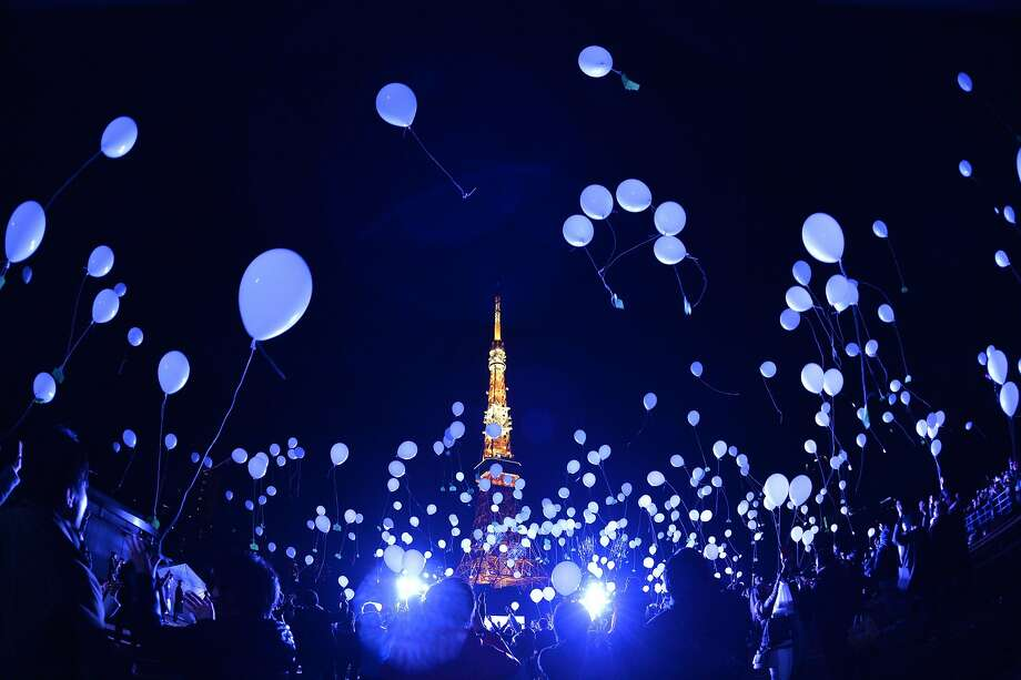 People release balloons to celebrate the New Year at the Prince Park Tower in Tokyo on January 1, 2016. More than 1,000 balloons were released, carrying with them new year wishes. Photo: Kazuhiro Nogi, AFP / Getty Images