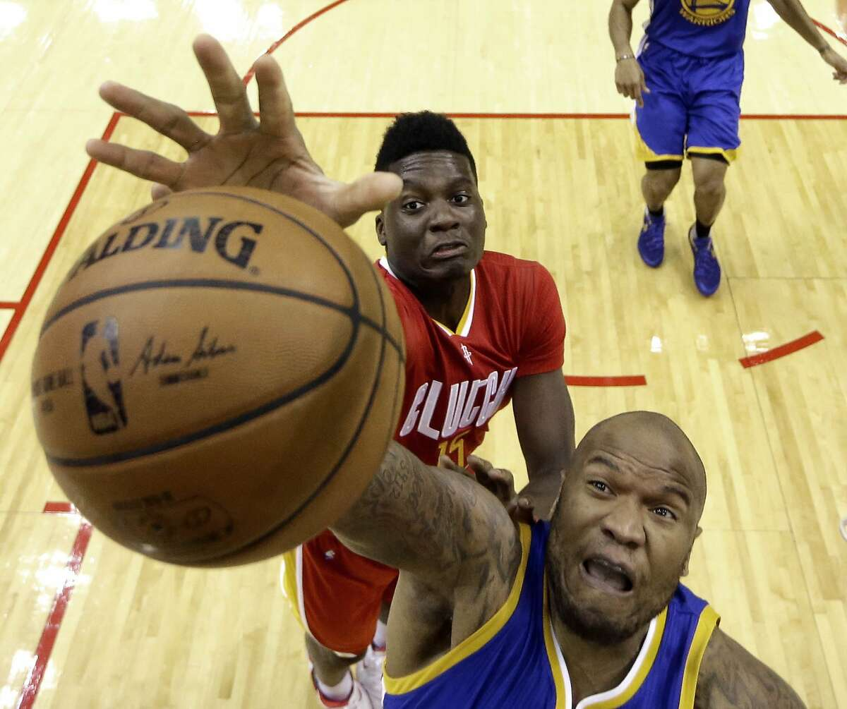 Golden State Warriors' Marreese Speights, bottom, and Houston Rockets' Clint Capela reach for a rebound during the first half of an NBA basketball game Thursday, Dec. 31, 2015, in Houston. (AP Photo/David J. Phillip)