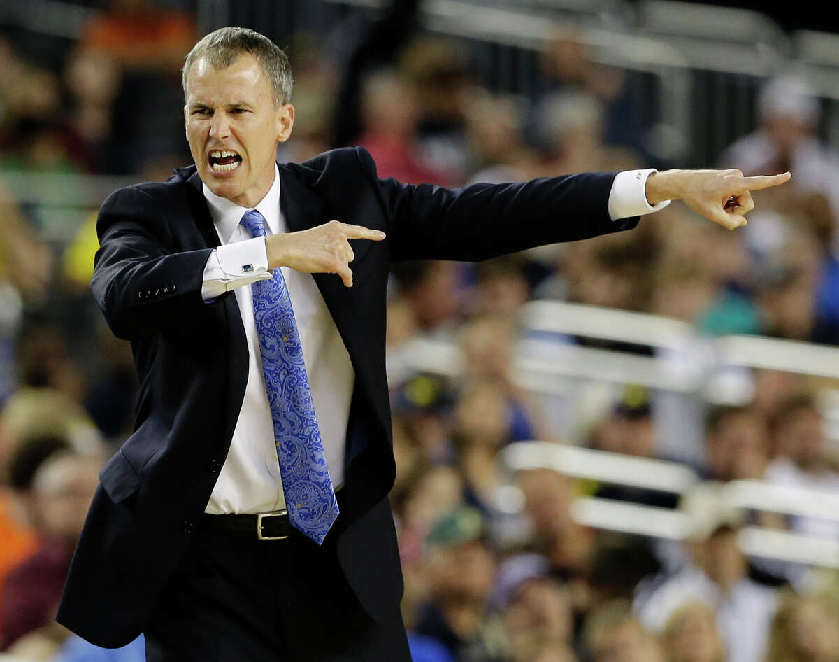 FILE - In this March 30, 2013, file photo, Florida Gulf Coast head coach Andy Enfield reacts to action against Florida during the second half of a regional semifinal game in the NCAA college basketball tournament in Arlington, Texas. Southern California hired Enfield as their new men's basketball coach on Monday night, April 1, 2013, after he took Florida Gulf Coast to the round of 16 of the NCAA tournament.(AP Photo/David J. Phillip, File)