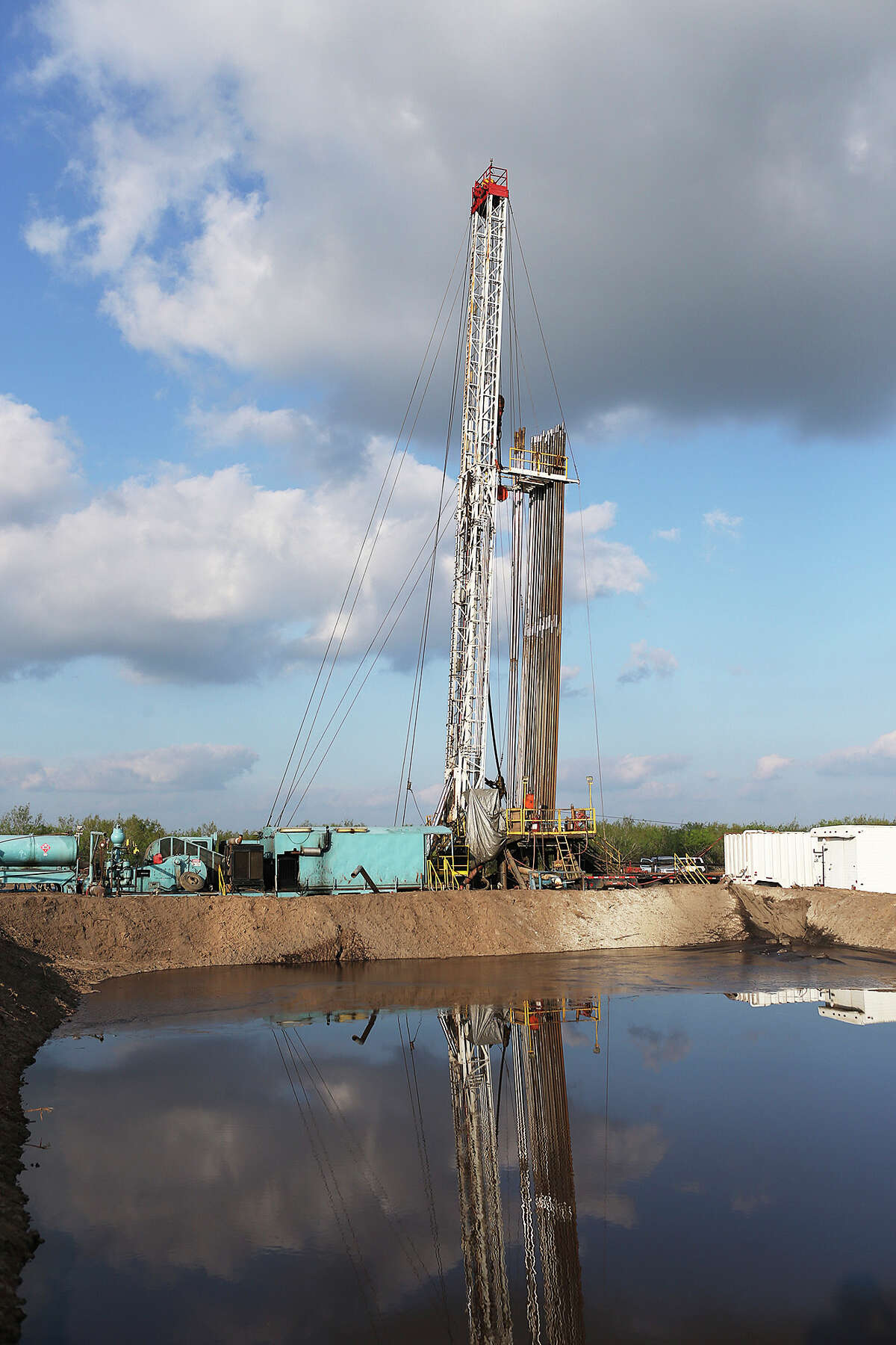 A Price Drilling rig stands on a ranch in Zavala County, on the edge of the Eagle Ford Shale. The number of active rigs in the shale play has tumbled from 200 to 76 since last January.
