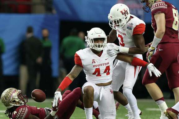 Houston Cougars linebacker Elandon Roberts (44) celebrates taking down Florida State Seminoles running back Dalvin Cook (4) for a loss of yards in the first half of Chick-fil-A Peach Bowl at the Georgia Dome on Thursday, Dec. 31, 2015, in Atlanta. ( Elizabeth Conley / Houston Chronicle )