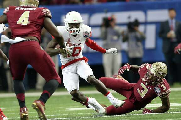 Houston Cougars wide receiver Demarcus Ayers (10) breaks a tackle for a first down in the first half of Chick-fil-A Peach Bowl at the Georgia Dome on Thursday, Dec. 31, 2015, in Atlanta. ( Elizabeth Conley / Houston Chronicle )