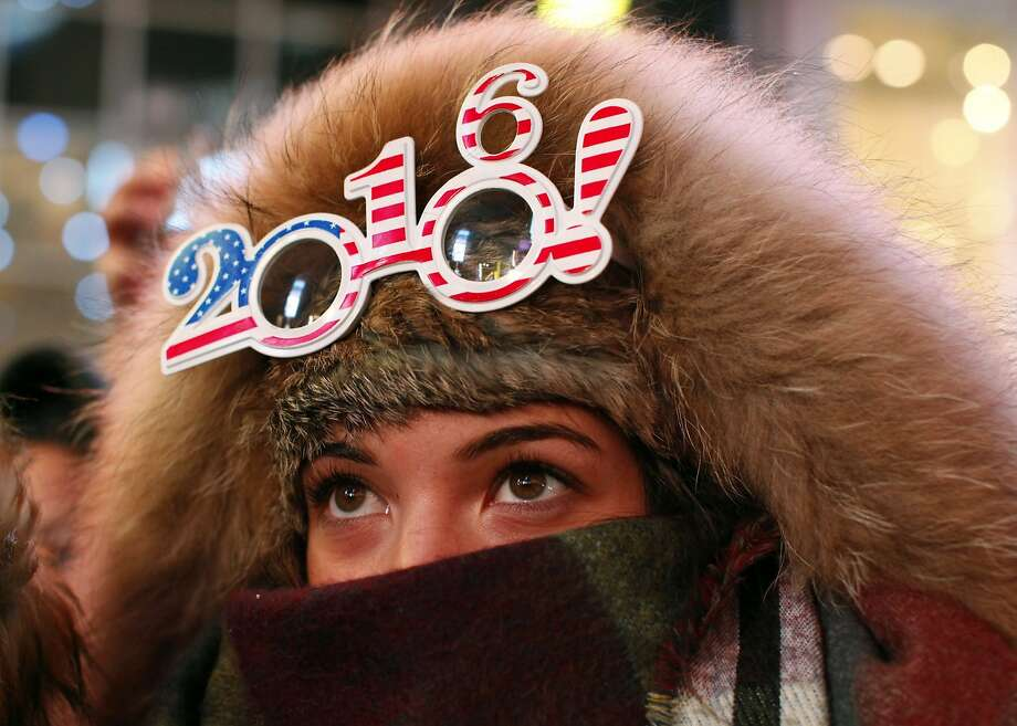 A reveler wears 2016 glasses at New Year's Eve celebrations in Times Square on December 31, 2015 in New York. Organizers expect around one million revelers at this year's event. AFP PHOTO/ KENA BETANCURKENA BETANCUR/AFP/Getty Images Photo: Kena Betancur, AFP / Getty Images