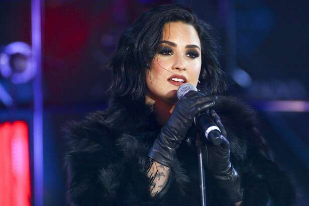 Demi Lovato performs at the Times Square New Year's Eve celebration on Thursday, Dec. 31, 2015, in New York. (Photo by Andy Kropa/Invision/AP)