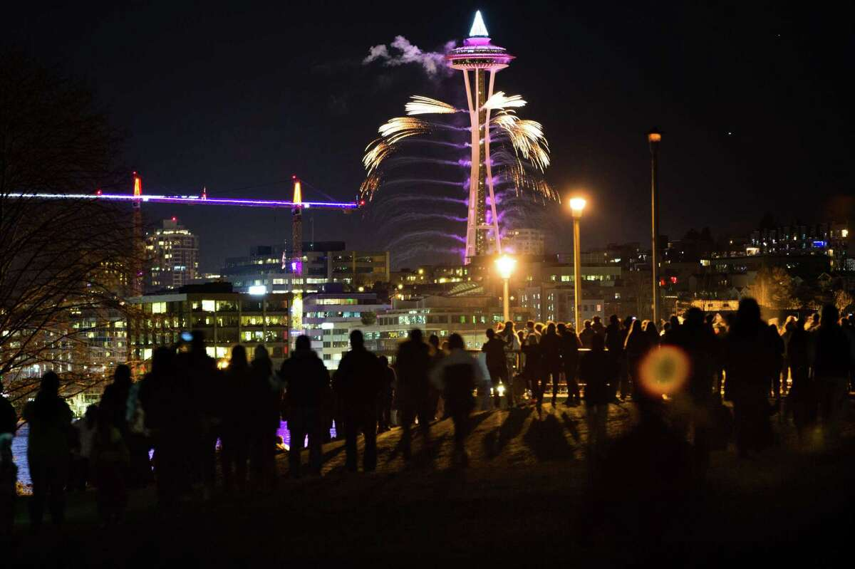 Fireworks are seen taking off of the Space Needle from Gas Works Park in celebration of the new year on Thursday, Dec. 31, 2015.