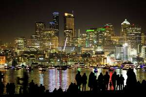 People prepare for fireworks at Gas Works Park in celebration of the new year on Thursday, Dec. 31, 2015.