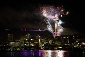 Fireworks are seen taking off of the Space Needle from Gas Works Park in celebration of the new year on Friday, Jan. 1, 2016.