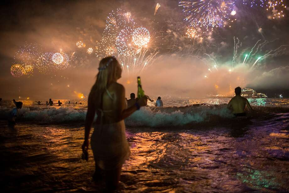 Fireworks light the sky over Copacabana beach during New Year's Eve celebrations in Rio de Janeiro, Brazil, Thursday, Jan. 1, 2016. Photo: Mauro Pimentel, Associated Press