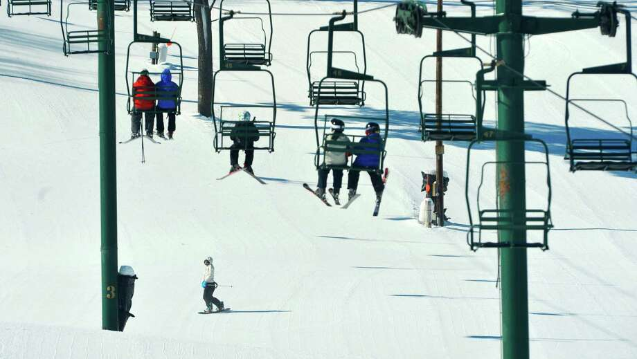 Skiers make their way up for another run as a snowboarder comes down at Maple Ski Ridge on Monday, Feb. 16, 2015, in Rotterdam, N.Y.  The Capital Region awaits its first big snowfall. (Paul Buckowski / Times Union) Photo: Paul Buckowski / 00030357A