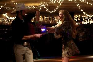 Patrons dance to country music on New Year's Eve at Tin Hall in Cypress, Texas.
