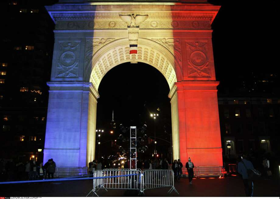 The Washington Square Arch in New York City is lit with the French national colors Nov. 14 in solidarity with the citizens of France after terrorists killed 130 people in Paris the day before. Photo: COHEN DIANE L /SIPA /COHEN DIANE L /SIPA / SPPFR