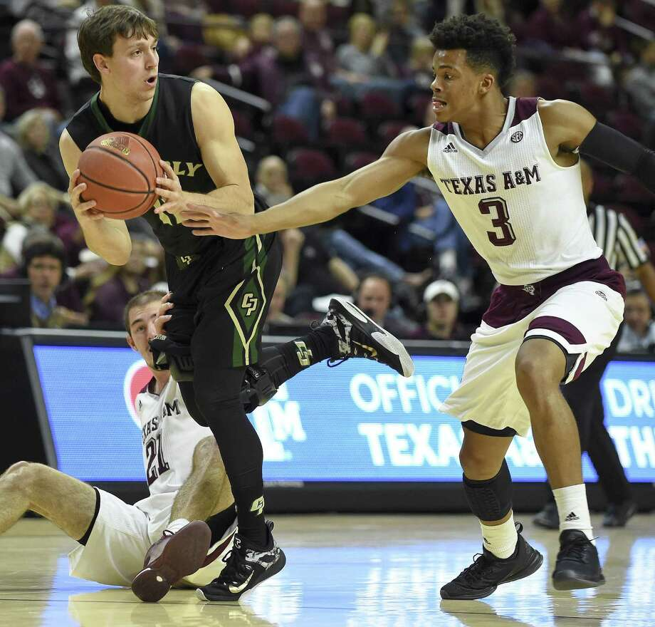 Cal Poly guard Taylor Sutlive, top left, looks to pass as Texas A&M guards Alex Caruso (21) and guard Admon Gilder (3) defend during the first half of an NCAA college basketball game, Tuesday, Dec. 29, 2015, in College Station, Texas. (AP Photo/Eric Christian Smith) Photo: Eric Christian Smith, FRE / Associated Press / FR171023 AP