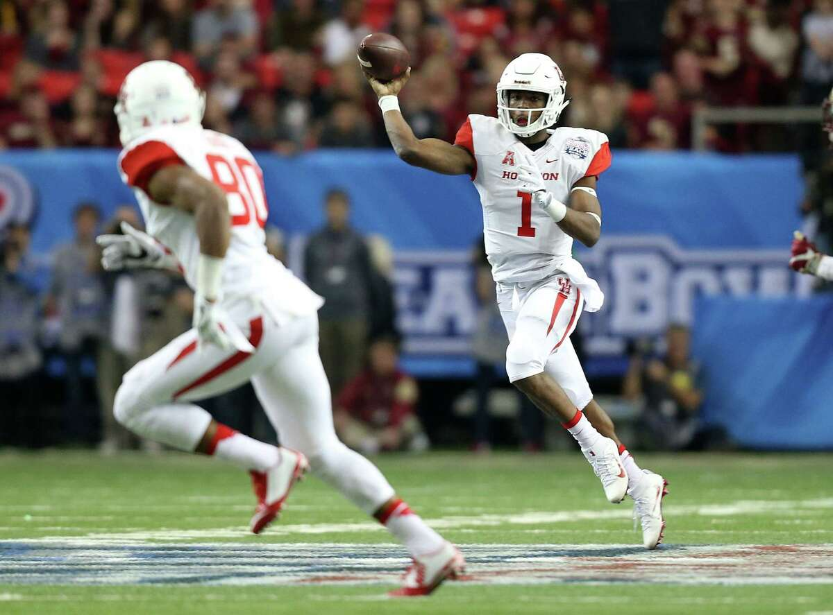 Houston Cougars quarterback Greg Ward Jr. (1) passes the ball to Houston Cougars wide receiver Cameron Oliver (80) in the second half of the Chick-fil-A Peach Bowl at the Georgia Dome on Thursday, Dec. 31, 2015, in Atlanta.
