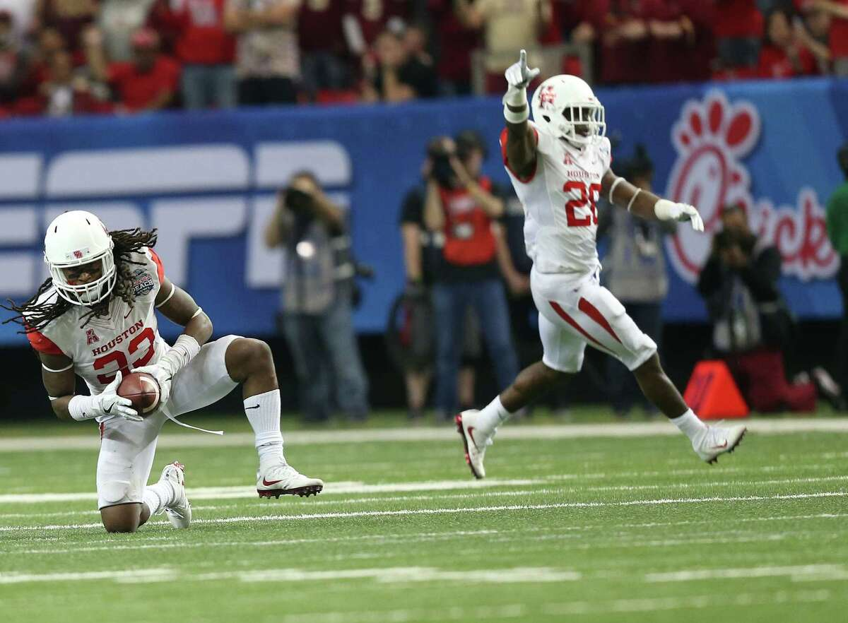 Houston Cougars defensive back Darius Gilbert (28) celebrates Houston Cougars safety Trevon Stewart (23) interception against Florida State Seminoles at the Georgia Dome on Thursday, Dec. 31, 2015, in Atlanta during the Chick-fil-A Peach Bowl.