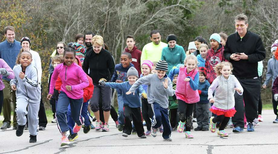 """A fast start kick off the event as kids and parents participate in a one mile """"1st Day Run"""" in the cold air at Government Canyon State Natural Area on January 1, 2016. Photo: TOM REEL, STAFF / SAN ANTONIO EXPRESS-NEWS / 2015 SAN ANTONIO EXPRESS-NEWS"""