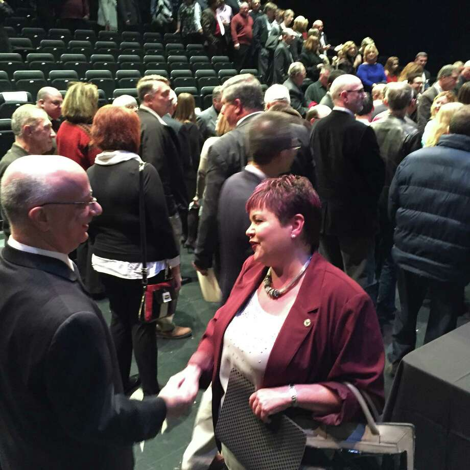 Newly sworn-in Schenectady City Council President Leesa Perazzo is congratulated by well-wishers after an annual City Council organizational meeting Friday at GE Theatre in Proctors. (Paul Grondahl / Times Union)