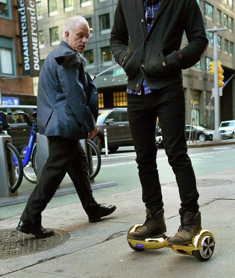 Whizboard Store manager 'Mor Loud'  demonstrates how the hoverboard works in New York. The devices, which more closely resemble a Segway without handlebars, have been linked to 14 emergency room visits at Memorial Hermann SugarLand Hospital. Photo: TIMOTHY A. CLARY, Staff / AFP