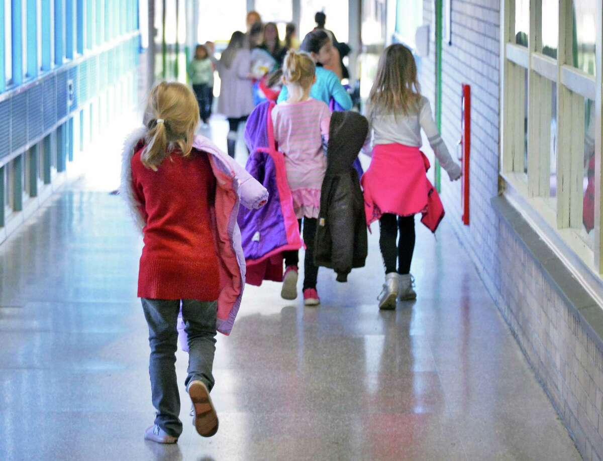 Students in the hallways at Forts Ferry Elementary School Tuesday Dec. 8, 2015 in Colonie, NY. (John Carl D'Annibale / Times Union)