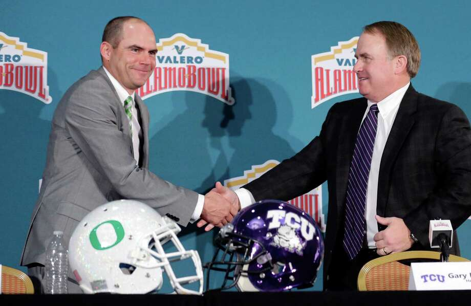 Oregon head coach Mark Helfrich, left, and TCU head coach Gary Patterson, right, shake hands following a news conference for the Alamo Bowl NCAA college football game, Friday, Jan. 1, 2016, in San Antonio. The two teams meet on Saturday. (AP Photo/Eric Gay) Photo: Eric Gay, STF / Associated Press / AP