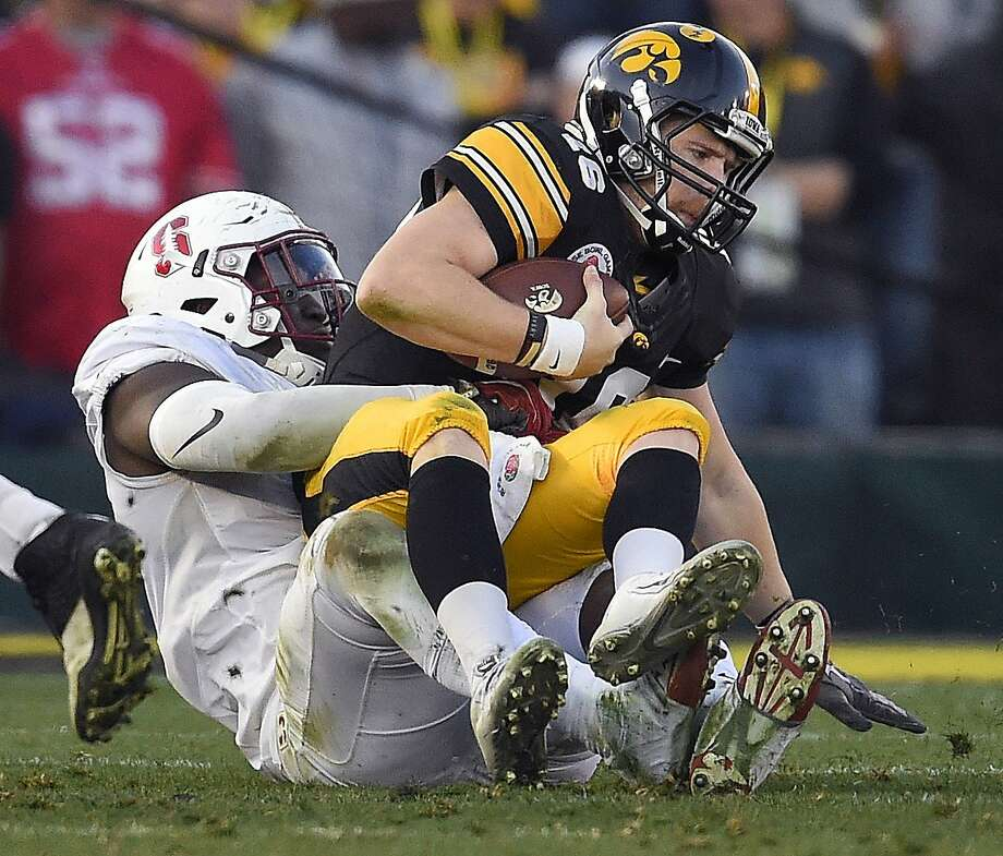 Azia Shittu sacks Iowa's C.J. Beathard in the second half. Photo: Mark J. Terrill, Associated Press