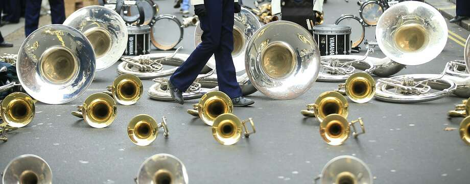 Members of the West Boca High School Vanguard marching band from Florida have their brass instruments laid out as they wait for the New Years Day Parade to begin in London Friday, Jan. 1, 2016. ( Photo: Alastair Grant, Associated Press