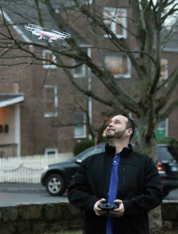 Pemberwick resident Anthony Altamirano flies his drone at Pemberwick Park in Greenwich, Conn. Thursday, Dec. 31, 2015. Altamirano, who also flies model airplane and helicopters, received the super-lightweight drone as a Christmas gift. Photo: Tyler Sizemore / Hearst Connecticut Media / Greenwich Time