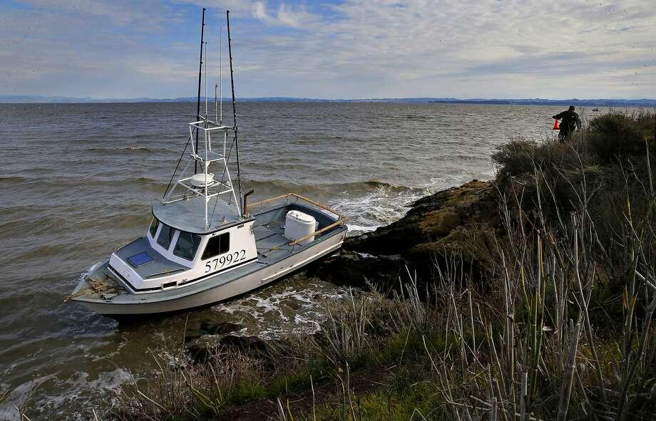 Fishing boat runs into rocks in San Pablo Bay