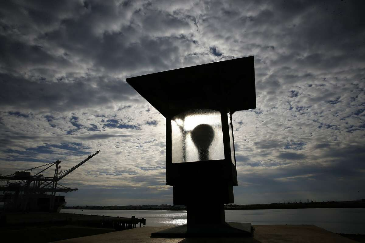 High clouds fill the skies above the observation tower at Middle Harbor Shoreline Park in Oakland, Calif. on Sat. January 2, 2016, with rain in the forecast for the Bay Area tomorrow.