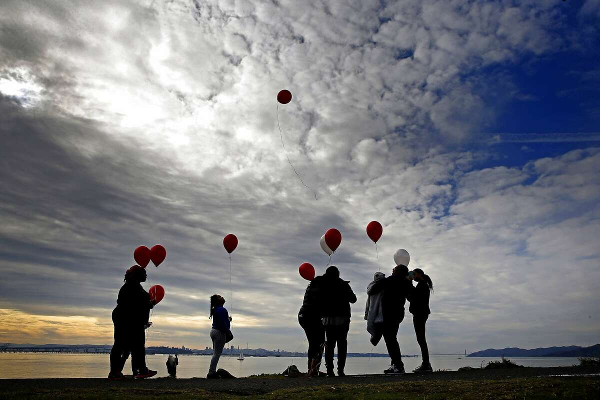 The Aaron family of Berkeley release their balloons into the skies above Cesar Chavez Park along the edge of San Francisco Bay in Berkeley, Calif. on Sat. January 2, 2016, in remembrance of their grandmother who passed away three years ago.