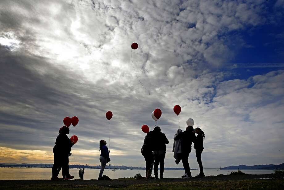 The Aaron family of Berkeley release their balloons into the skies above Cesar Chavez Park along the edge of San Francisco Bay in Berkeley, Calif. on Sat. January 2, 2016, in remembrance of their grandmother who passed away three years ago. Photo: Michael Macor, The Chronicle
