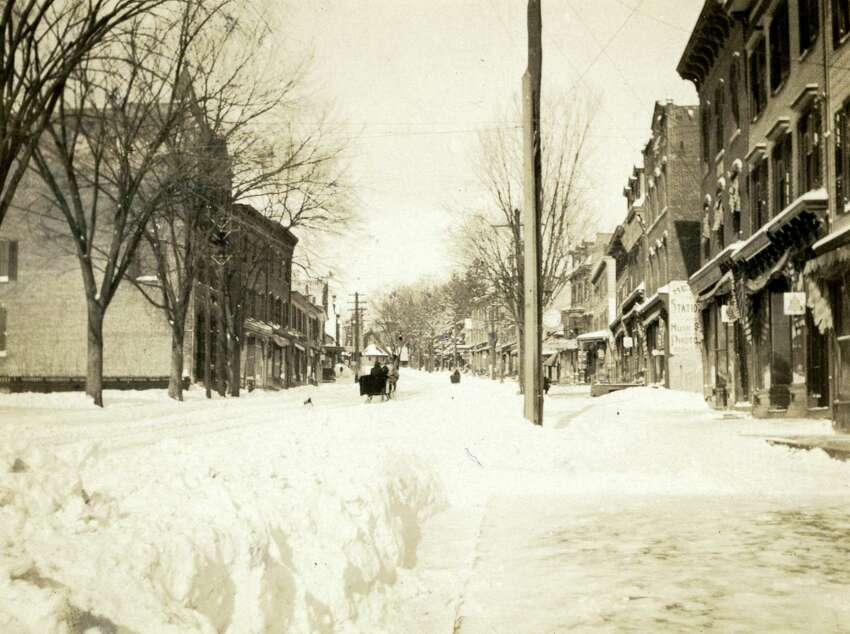 Greenwich Avenue is covered in snow in 1900.