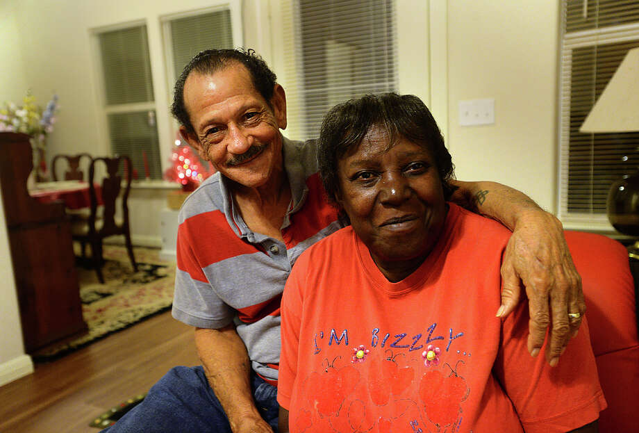 Alice and Leroy Savoy are pictured at their new home in Beaumont Wednesday. The Savoy's recently received the funds from the Hurricane Ike rebuilding program and moved in to the home on Gill Street in November, just in time for the holidays.  Photo taken Wednesday, December 16, 2015  Kim Brent/The Enterprise Photo: Kim Brent / Beaumont Enterprise