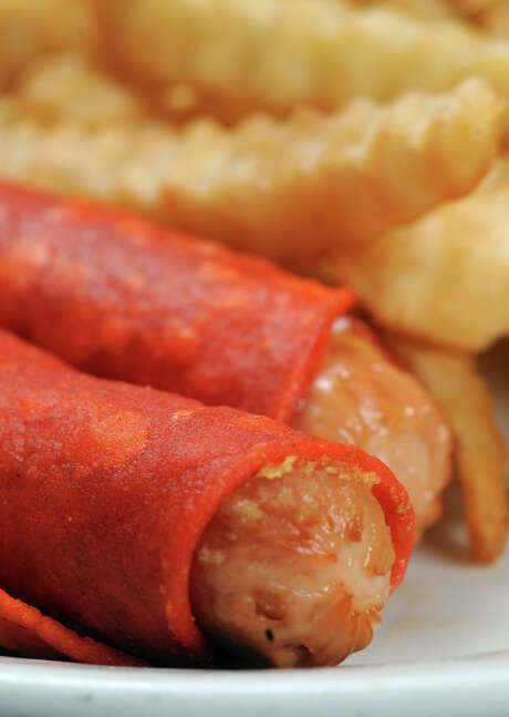 Crispy dogs with fries from the Malt House. Photo: 2010 San Antonio Express-News File Photo / Robert Jerstad