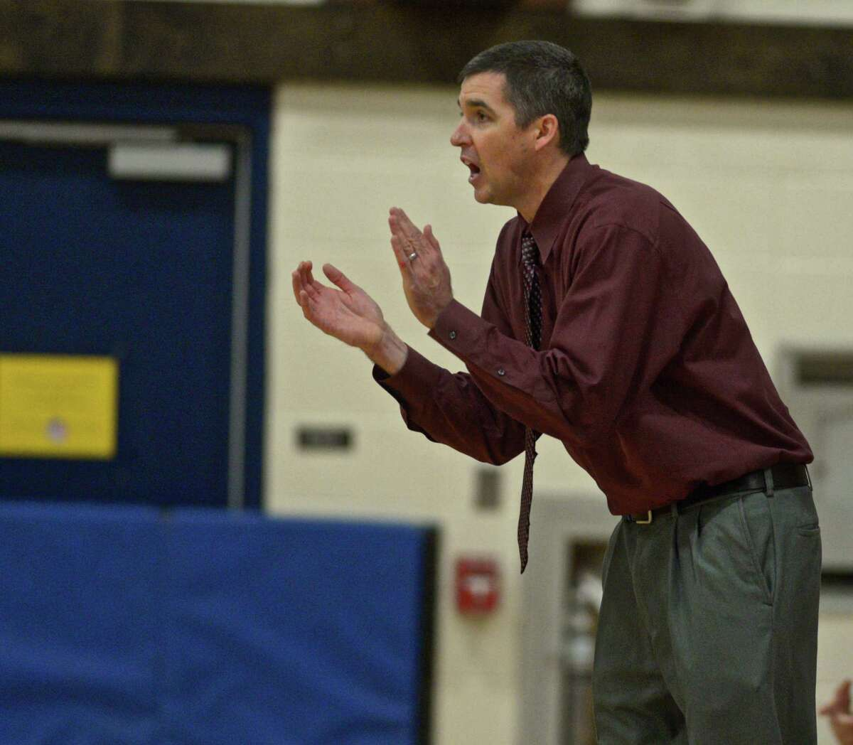 Foran head coach Tim Swaller watches his team during the boys high school basketball game between Foran and Brookfield high schools on Saturday, January 2, 2016, at Brookfield High School, Brookfield, Conn.