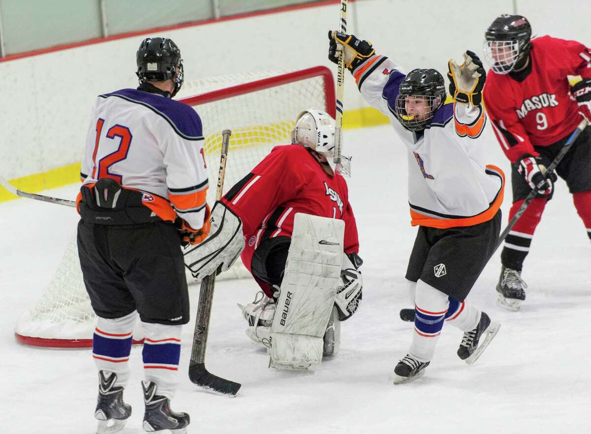 The Westhill-Stamford co-op teamís Cooper Healycelebrates scoring a goal during a boys ice hockey game against Masuk High School played at Terry Connors Rink, Stamford, CT on Saturday, January 2, 2016.