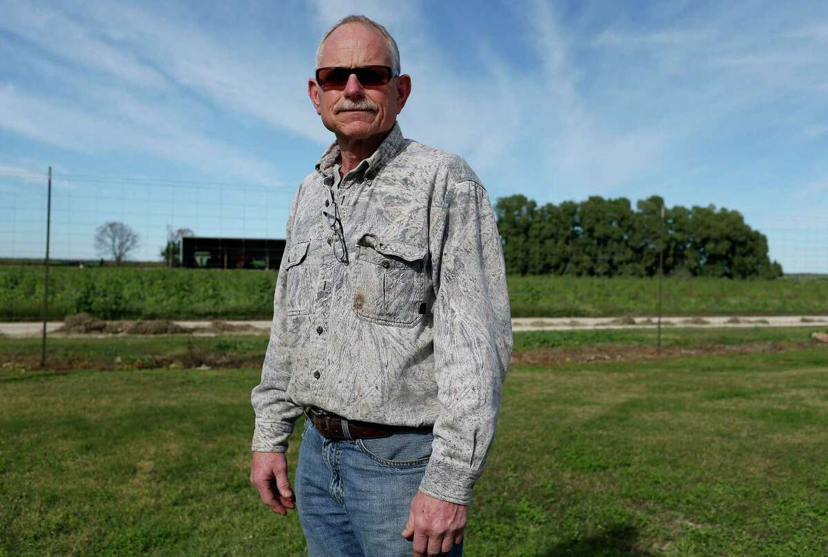 Richard Collier, Zavala County rancher, poses outside the Leona Valley Gin as he picks up a load of cottonseed for deer feed at the gin near Batesville, Texas, Wednesday, Dec. 23, 2015. Collier owns a pipe company that sells to oil drilling companies. With the downturn in the oil business, his sales have dropped.