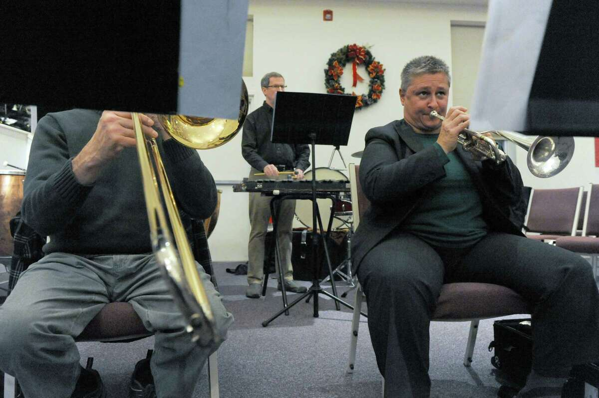Cathy Sheridan, a very busy trumpeter who jobs-in all over the place, plays at a rehearsal of the Burnt Hills Oratorio Society at the Grace Chapelon Tuesday Dec. 1, 2015 in Clifton Park, N.Y. (Michael P. Farrell/Times Union)