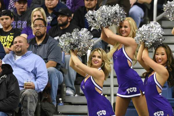 The TCU dance team members perform in the stands during the Valero Alamo Bowl in the Alamodome on Saturday, Jan. 2, 2016.