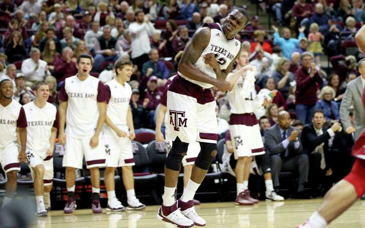 Texas A&M's Jalen Jones (12) celebrates a slam-dunk against Arkansas during an NCAA college basketball game Saturday, Jan. 2, 2016, in College Station, Texas. (AP Photo/Sam Craft)