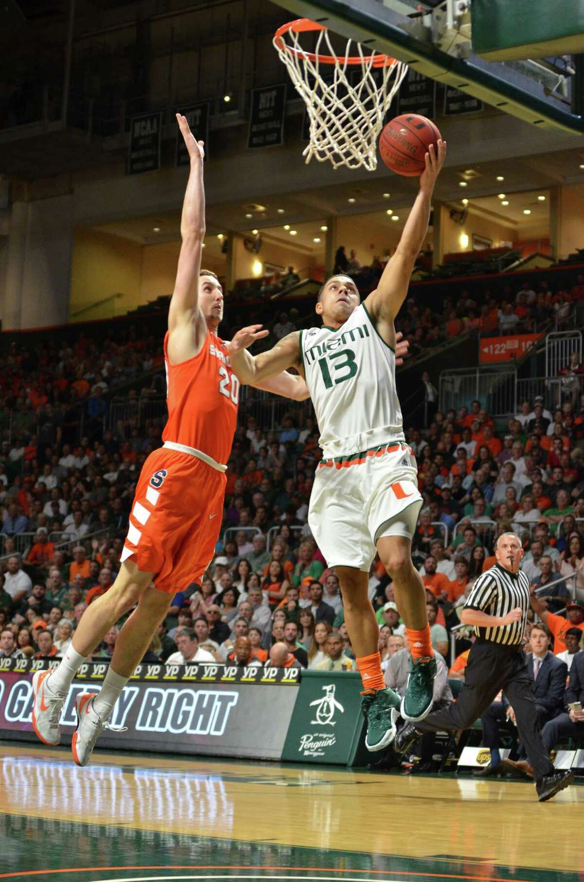 Miami guard Angel Rodriguez goes up for a lay up against Syracuse's Tyler Lydon during the first half of an NCAA college basketball game in Coral Gables, Fla., Saturday, Jan. 2, 2016. (AP Photo/Gaston De Cardenas) ORG XMIT: FLGC103