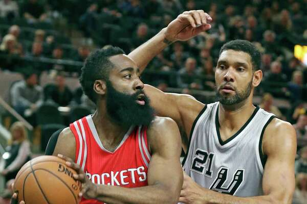 Houston Rockets' James Harden looks for room around San Antonio Spurs' Tim Duncan during first half action Saturday Jan. 2, 2016 at the AT&T Center.