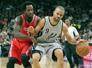 Spurs' Tony Parker looks for room around Houston Rockets' Patrick Beverley during second half action on Jan. 2, 2016 at the AT&T Center.