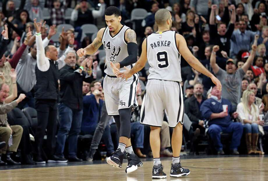 Spurs' Danny Green celebrates with teammate Tony Parker after making a 3-pointer during first half action against the Houston Rockets Saturday Jan. 2, 2016 at the AT&T Center. Photo: Edward A. Ornelas /San Antonio Express-News / © 2016 San Antonio Express-News