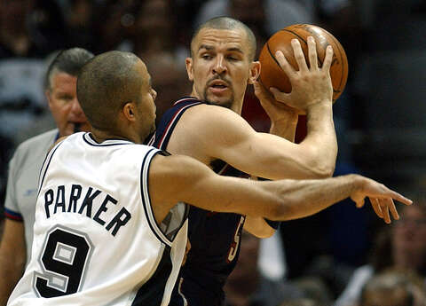 8460094c182 Spurs  Tony Parker defends Nets  Jason Kidd during first quarter action of  Game 6