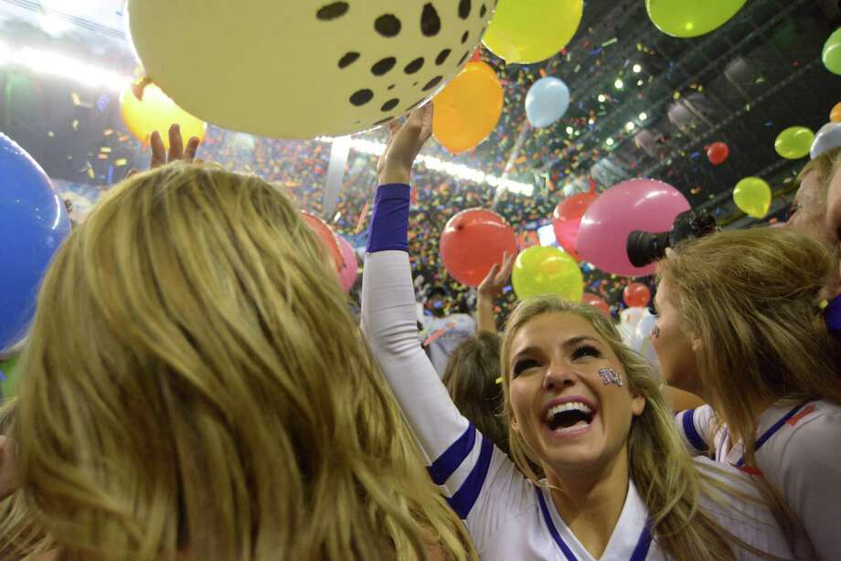 TCU cheerleaders celebrate their football team's 47-41 victory over Oregon in the Valero Alamo Bowl in the Alamodome on Saturday, Jan. 2, 2016. Photo: Billy Calzada, San Antonio Express-News / San Antonio Express-News