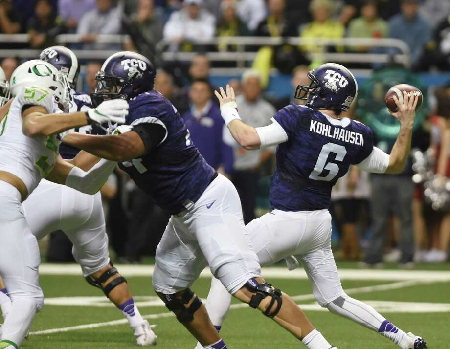 Quarterback Bram Kohlhausen of TCU throws an intercepted pass during first-half action of the Valero Alamo Bowl against Oregon in the Alamodome on Saturday, Jan. 2, 2016. Photo: Billy Calzada, San Antonio Express-News / San Antonio Express-News