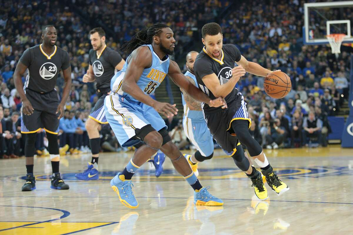 Golden State Warriors guard Stephen Curry (30) dribbled past Denver Nuggets forward Kenneth Faried (35) during the first half of an NBA basketball game, Saturday, Jan. 2, 2016, at Oracle Arena in Oakland, Calif.