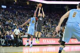 Golden State Warriors guard Klay Thompson (11) takes a shot against Denver Nuggets forward Darrell Arthur (00) during the first half of an NBA basketball game, Saturday, Jan. 2, 2016, at Oracle Arena in Oakland, Calif.